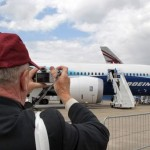 A man takes a picture of a Boeing 787 Dr